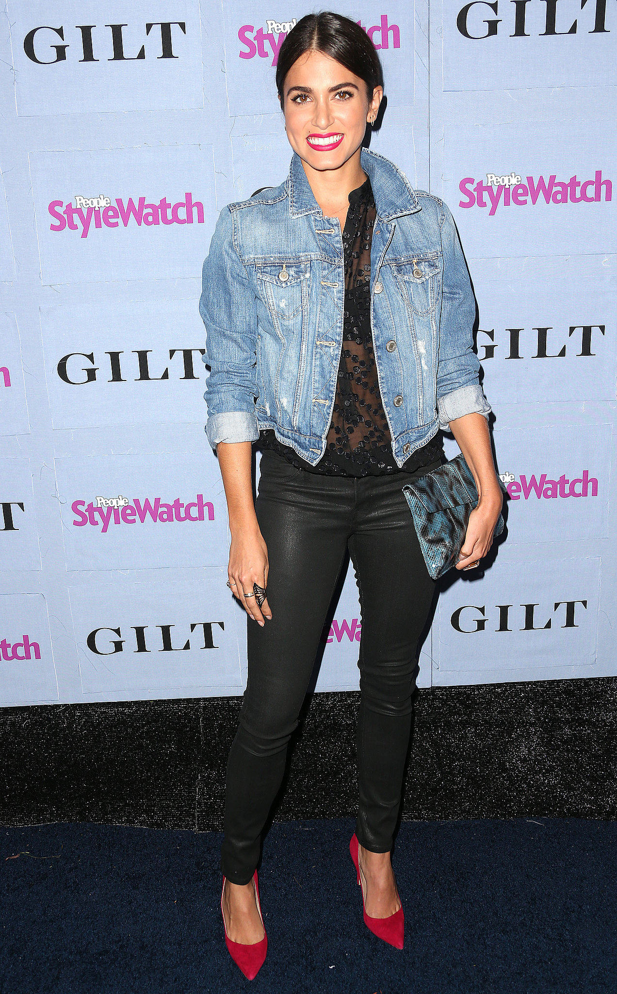 Nikki Reed played leather pants against her denim jacket for a cool effect at the People StyleWatch Denim Awards in September 2013.