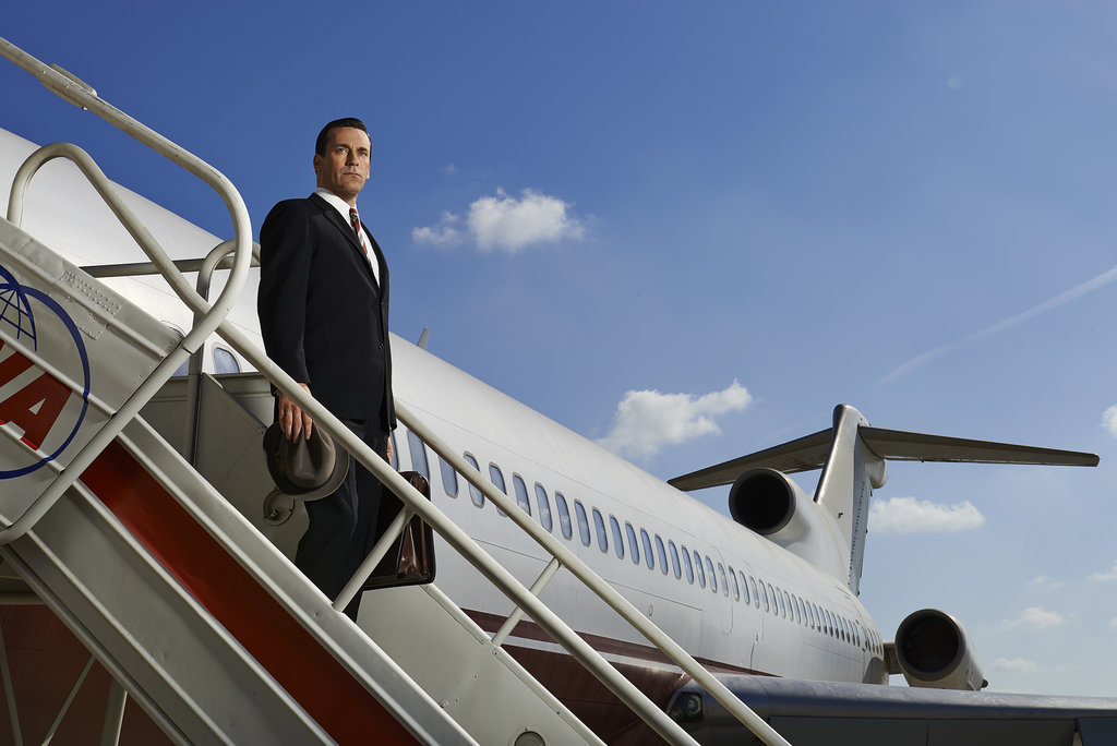 Don disembarks the plane.