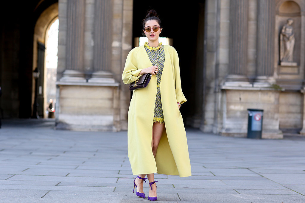 We love how this ultra-bright coat picks up the colours in her dress.