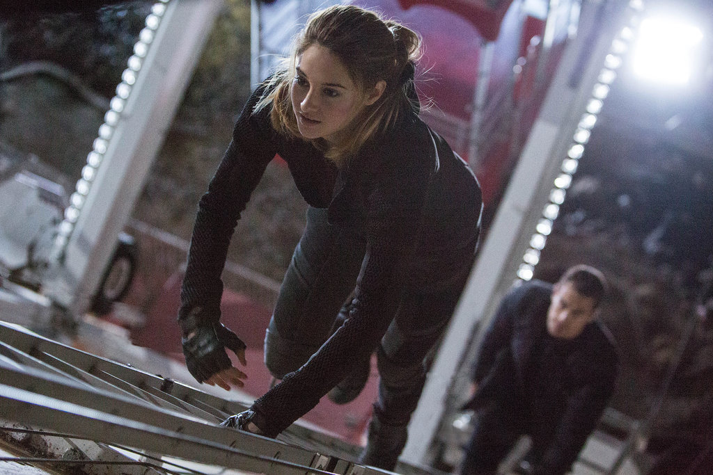 Tris and Four climb up the Ferris wheel.