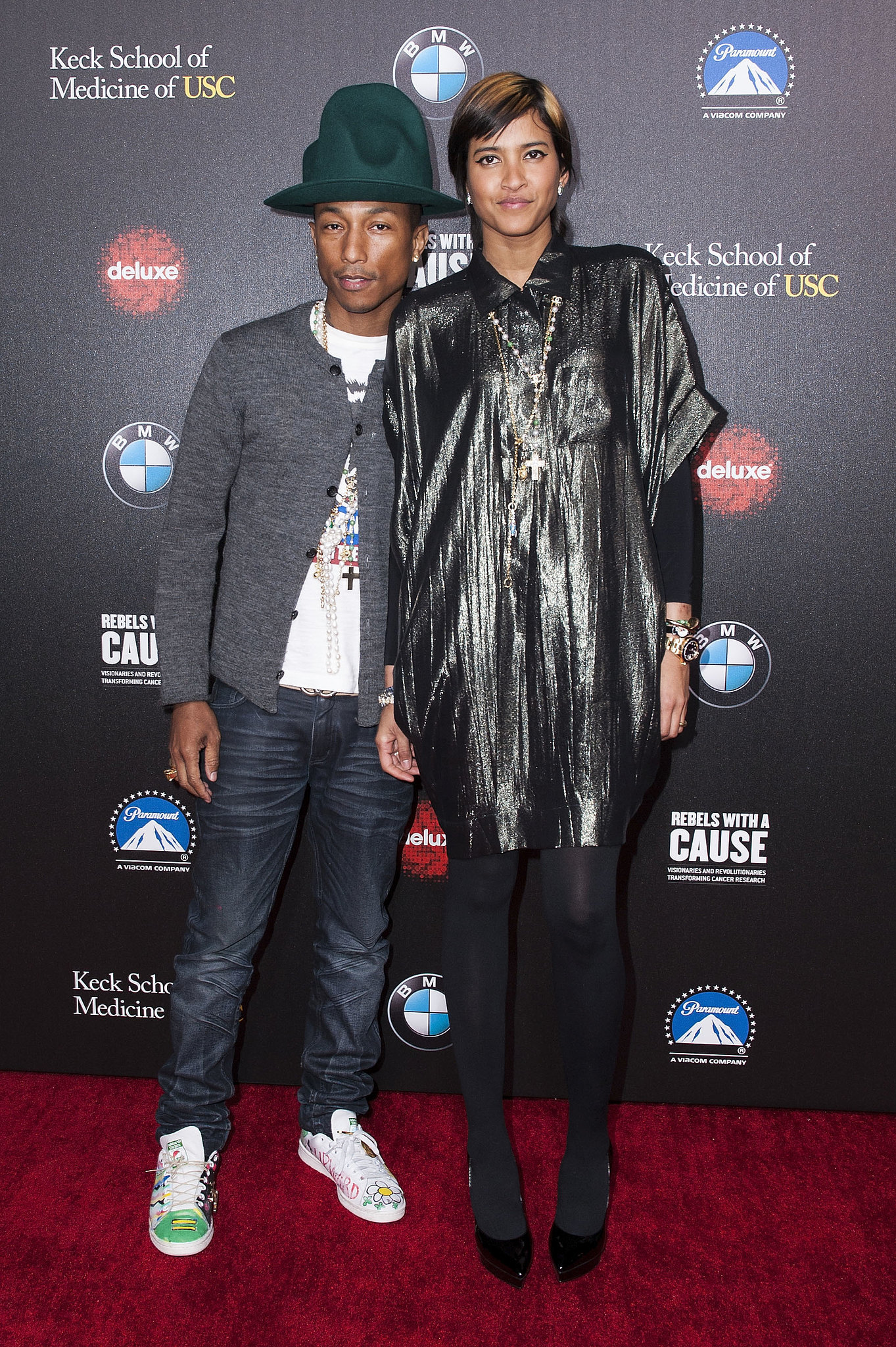 Pharrell Williams wore a green version of his infamous hat alongside his wife, Helen Lasichanh.