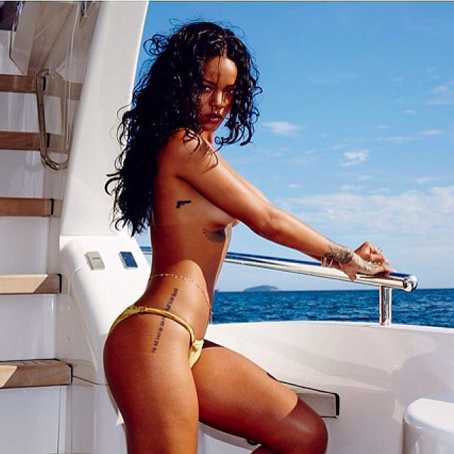 Rihanna went topless during a yacht excursion.  Source: Instagram user badgalriri