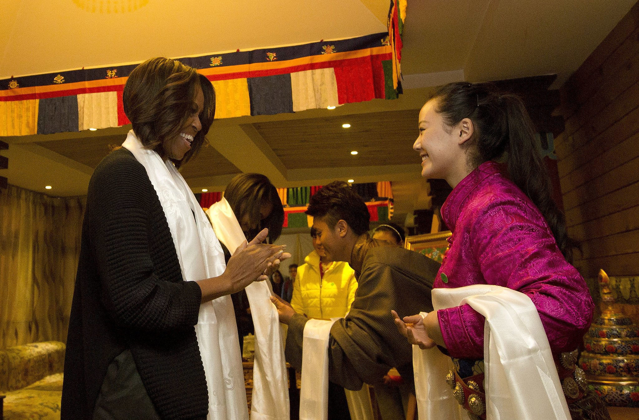 The first lady received a Tibetan scarf when she and her daughters were greeted at the restaurant.