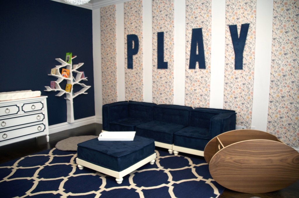 """PS: What are some things that a parent should consider when designing a room for children? VA: They grow and evolve so quickly, it's hard to know what will last. Little people have a lot of stuff, so storage [is crucial]. You will never find a parent who said, """"Darn, I wish I created a space with less storage."""" As far as design, I always tell my clients that if your goal is longevity, do not get too theme-y. The superheroes your child loves now may not be what they want on their walls in high school. If you just can't let go of the theme, make it something that you can easily change. For example, in Alena's playroom, those wall panels are covered with wallpaper. If down the road she no longer likes birds, they are just covering the panels with something new. Quick, easy, and inexpensive changes. Source: Vanessa Antonelli for Nessa Lee Baby"""
