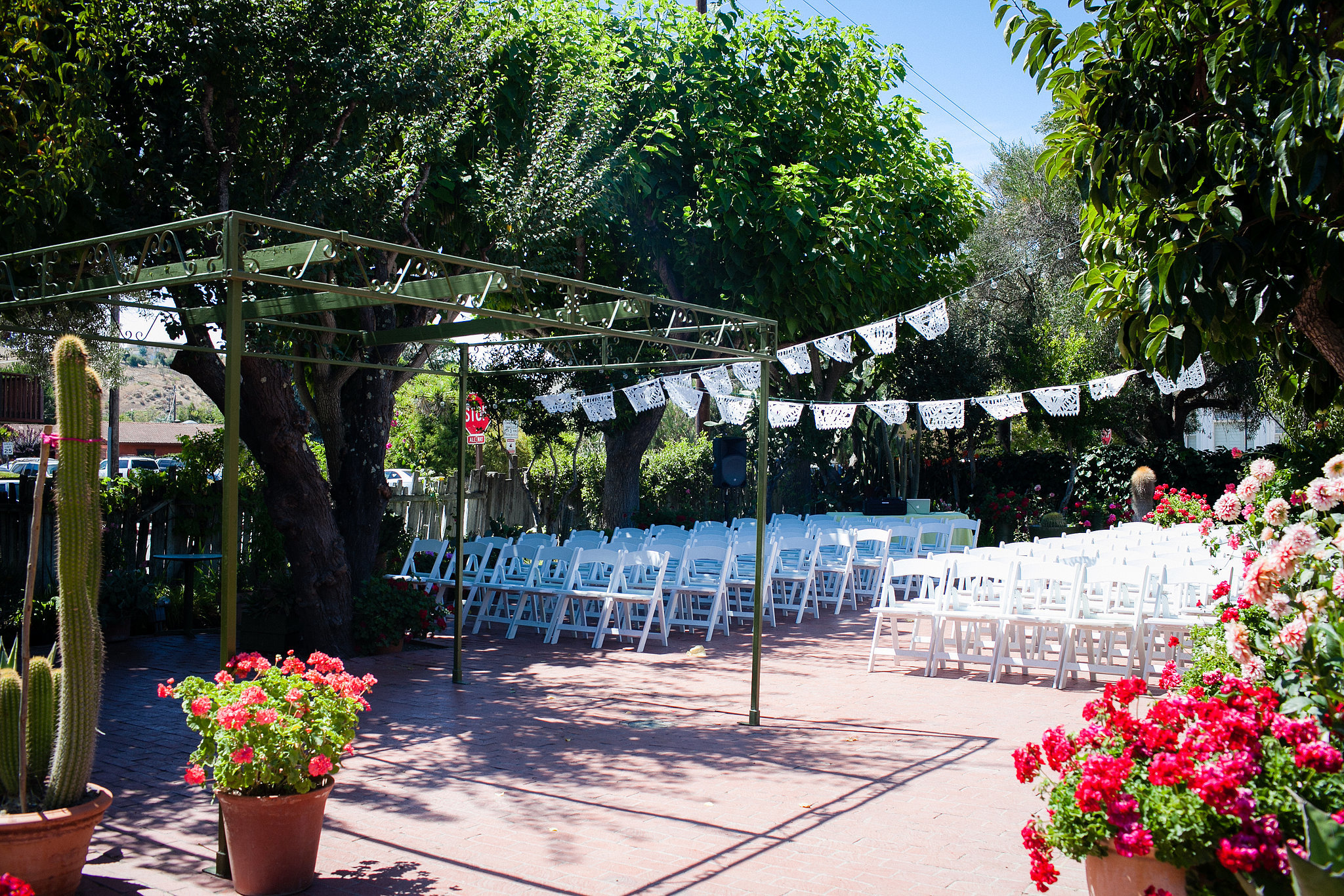 """Where did the wedding take place, and why did you choose it? """"We stumbled across San Juan Bautista the Summer before our wedding, when we were camping nearby with friends. One of them mentioned the mission there, so we stopped by and treated ourselves to brunch at Jardines de San Juan, which happened to have a beautiful back garden in addition to the great food (and margaritas!). It popped up on a list of gay-friendly venues when we started our search not long after that, so we knew it was meant to be. We even got to take our postceremony shots on the mission grounds!"""" Photo by G Aranow Photography"""