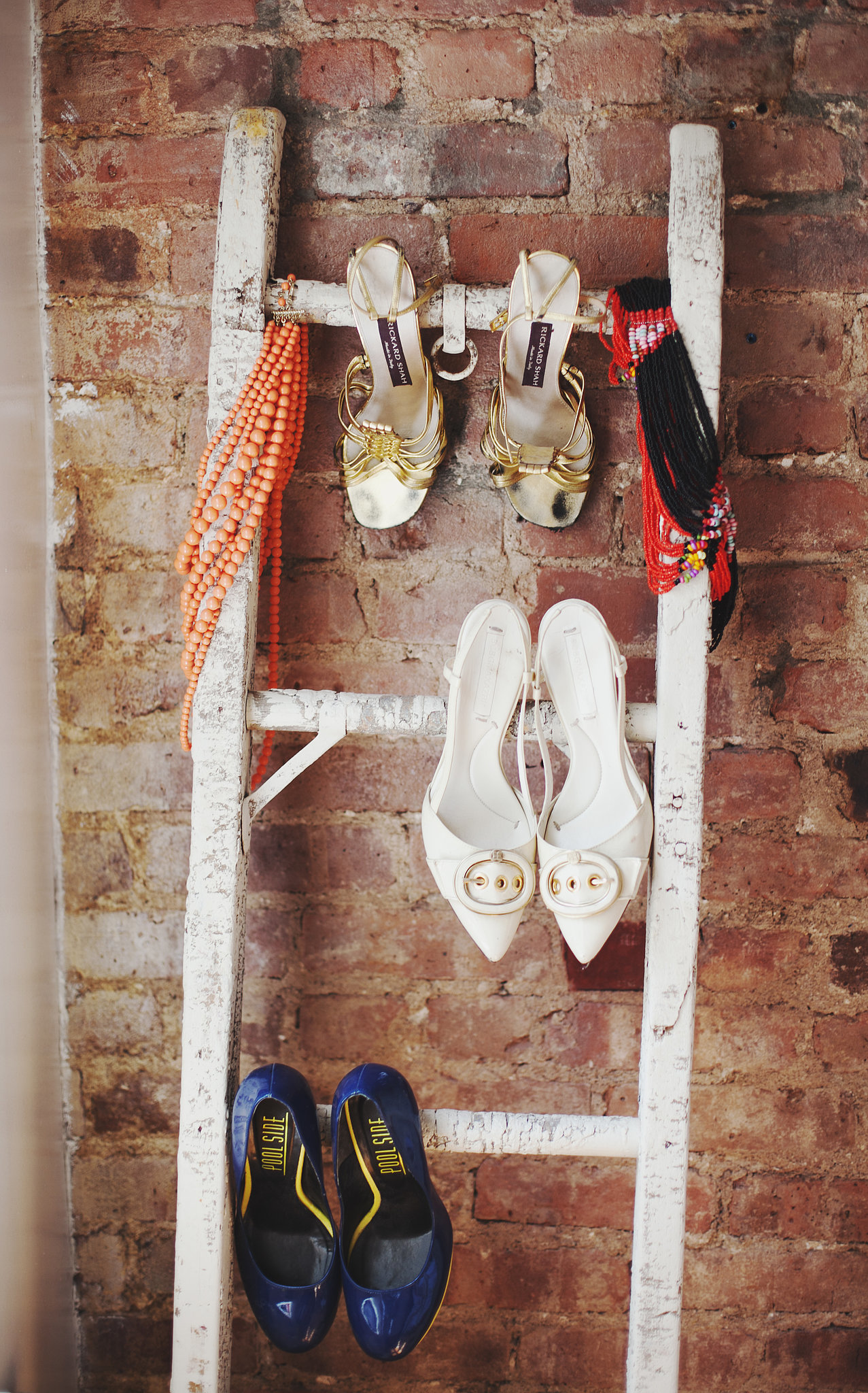 A repurposed ladder offers additional shoe storage. Such a great idea!  Photo by Chellise Michael via Homepolish