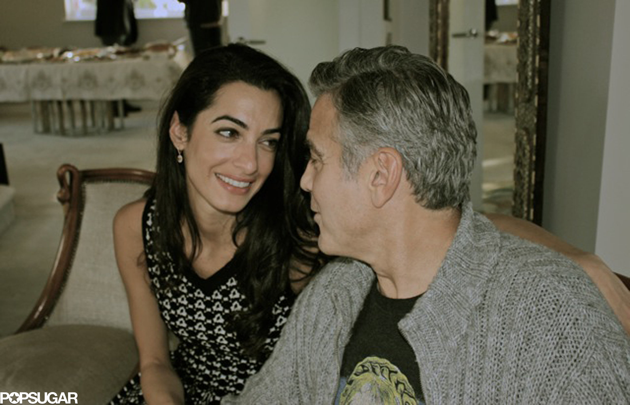 George and Amal gave each other a loving glance while in Tanzania in March 2014.