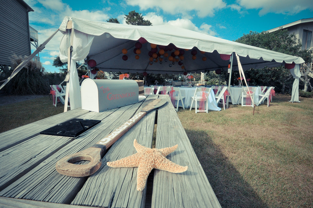 A rustic table and starfish complete the setup. Photo by Bryce Lafoon Photography