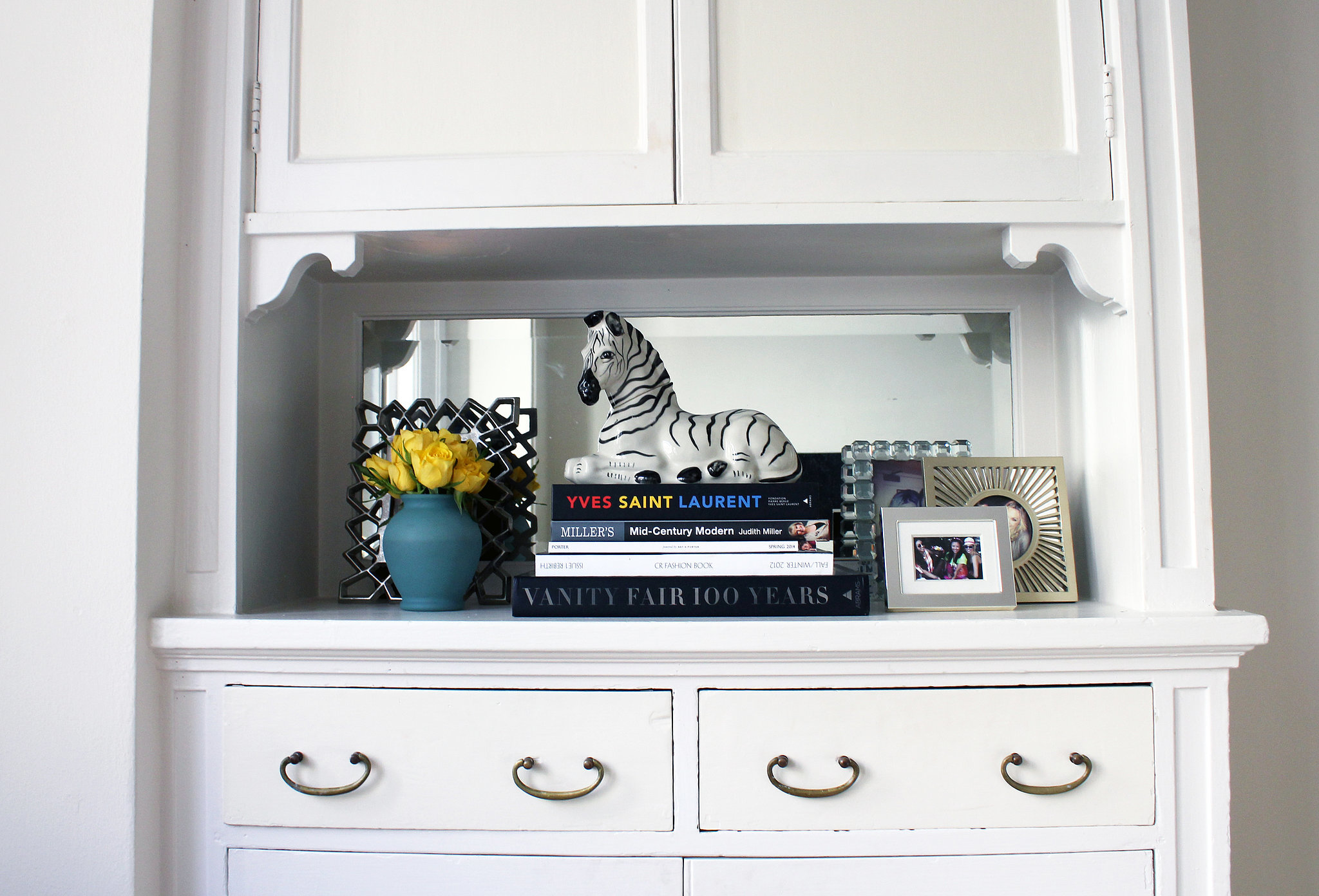 Can you believe this zebra is actually a whiskey decanter? Looks like it's right at home in the middle of those timeless stacked books and frames.