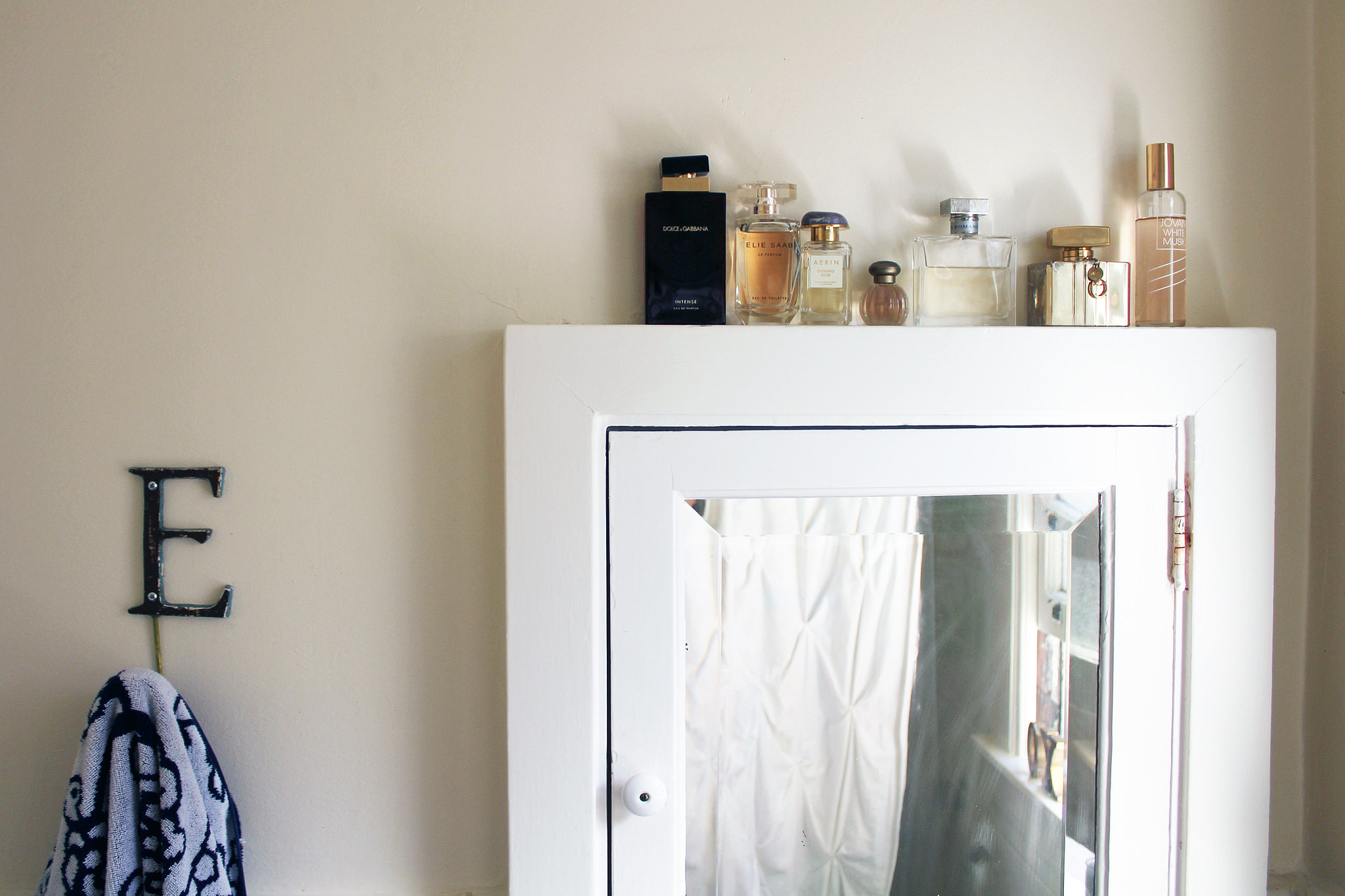 As for the bathroom, decor comes in the form of beautiful perfume bottles.