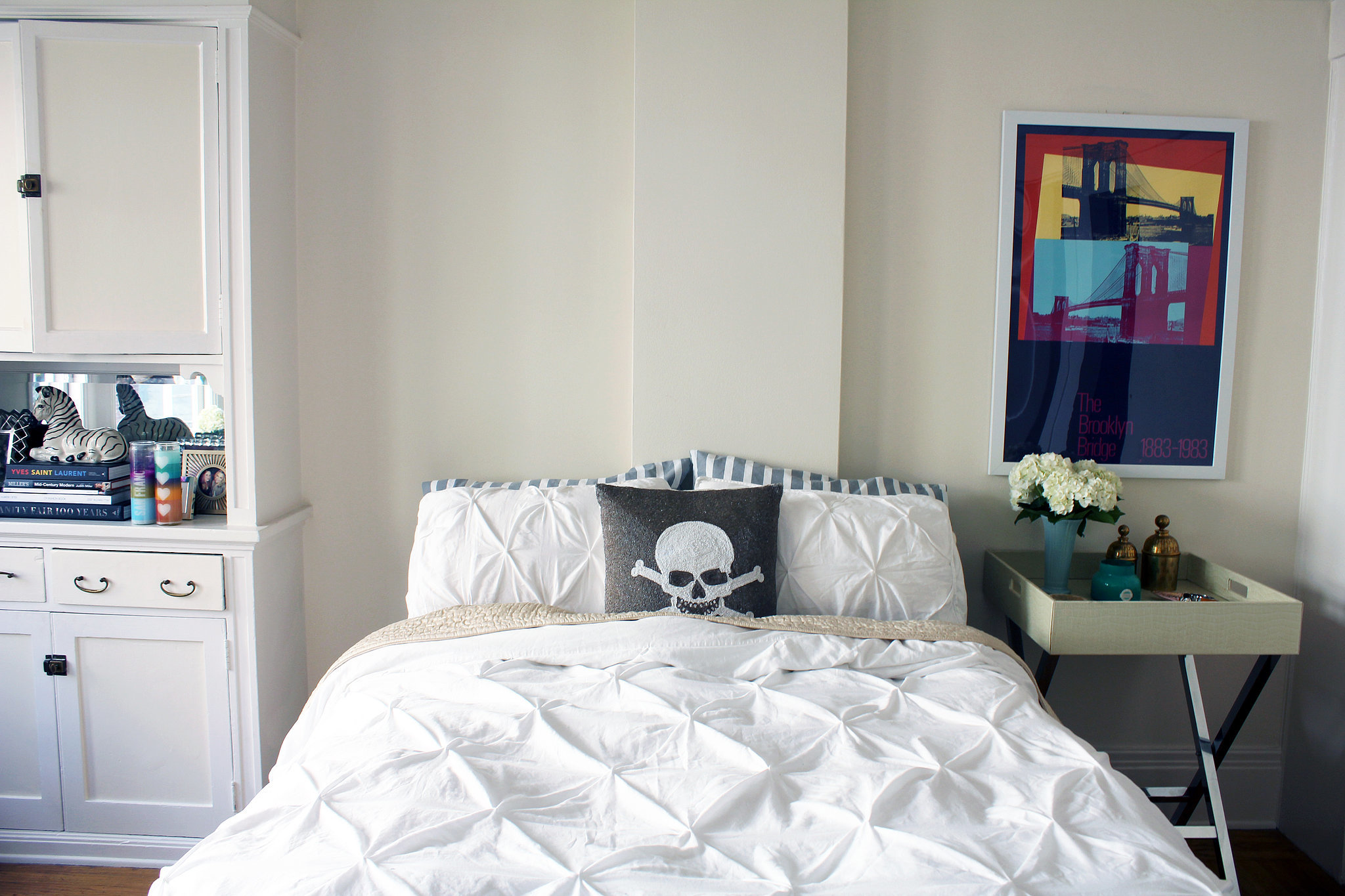 Just about every inch of the apartment has a touch of fun, like the pirate pillow on Emily's bed. It's all part of her philosophy: splurge on the big stuff like furniture but save on smaller items like pillows and bedding because you'll want to switch them up more often.