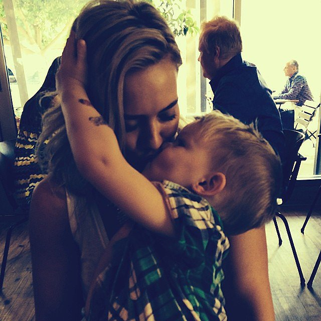 Hilary Duff gave her son, Luca, a smooch. Source: Instagram user hilaryduff
