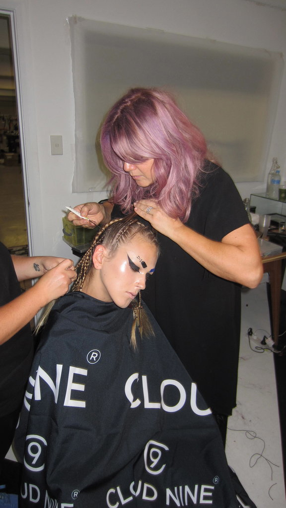 """""""There will be four or five looks for the hair,"""" says Cloud Nine's Renya Xydis. """"The inspiration was pop culture, cartoon, hip-hop, animated and gangsta girls. So we are basically just doing a lot of cornrowing and then safety pinning, pre-coloured and pre-ironed pieces on to the ends of the hair to suit the colourful and crazy clothes. The look is polished, yet a little grungy."""""""