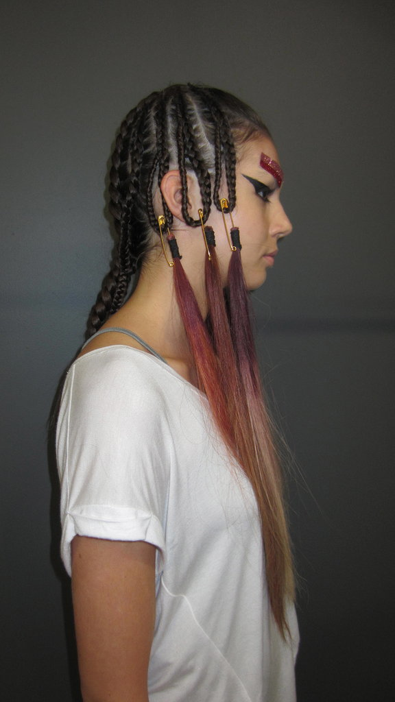 """""""Cornrows are cool,"""" she adds. """"They can be hard, rock chick or feminine and beautiful, but everyone loves a plait. I try and do looks are really crafty or arty or beautiful or very sexy, but I always like them to be able to go from the catwalk to the chair. So you can take an element (the colour, the braids, the liner) and be inspired to take something from it to use in your everyday life."""""""