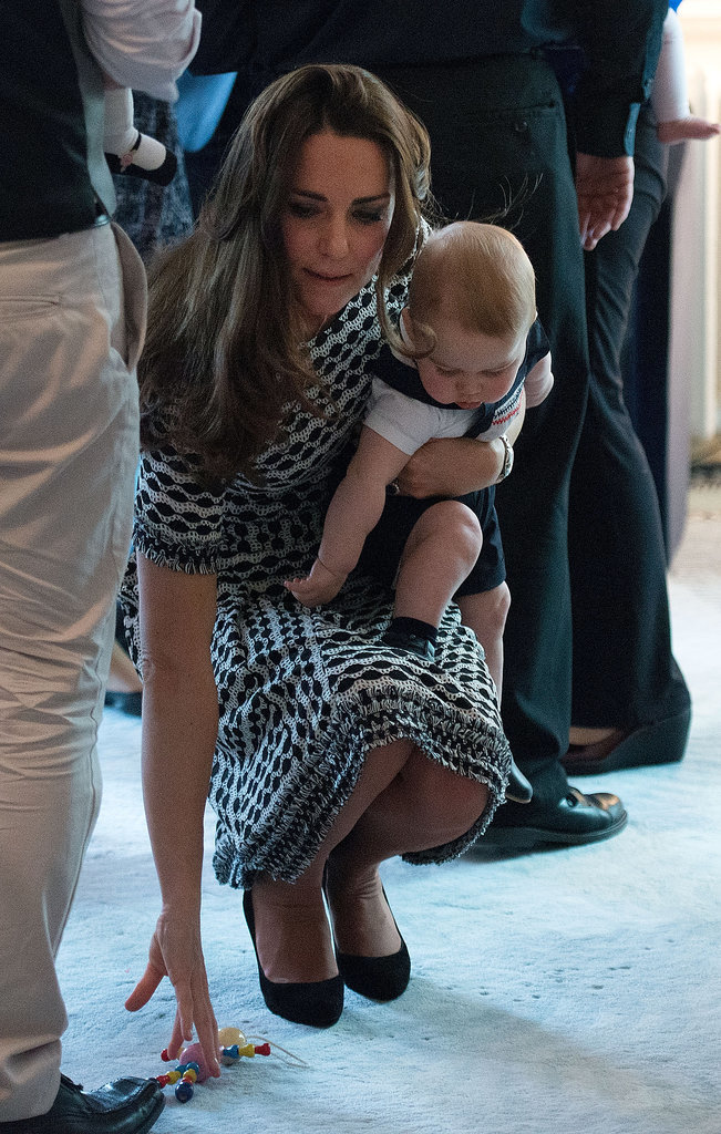 There was a mom moment for Kate, when she bent down to pick up a toy that Prince George dropped during their April 9 playdate at Government House.