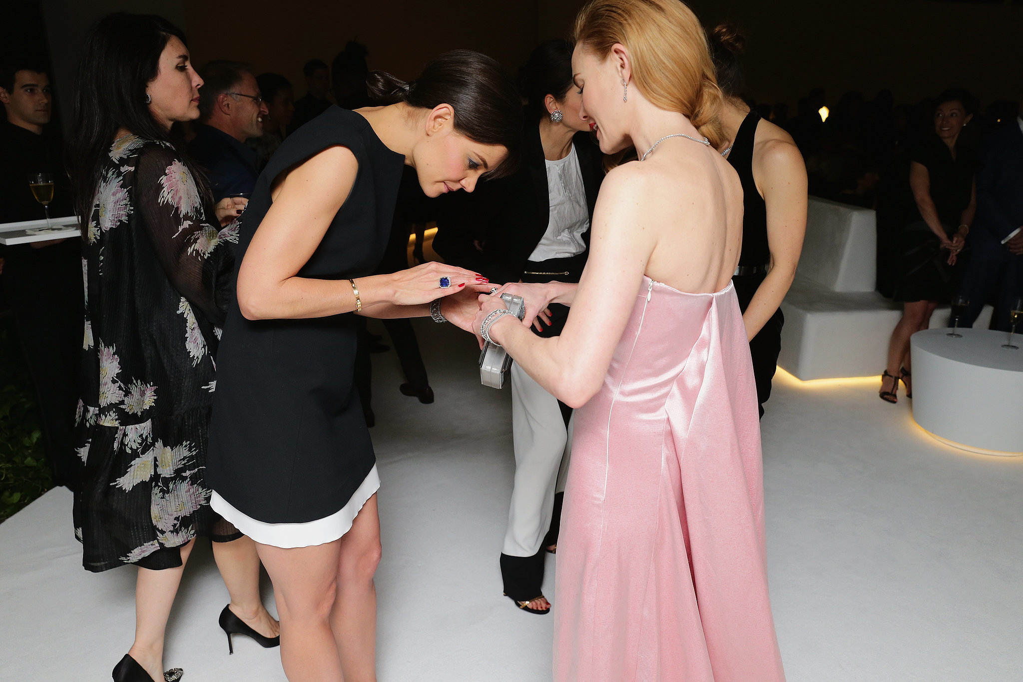 Katie inspected Kate's jewelry.