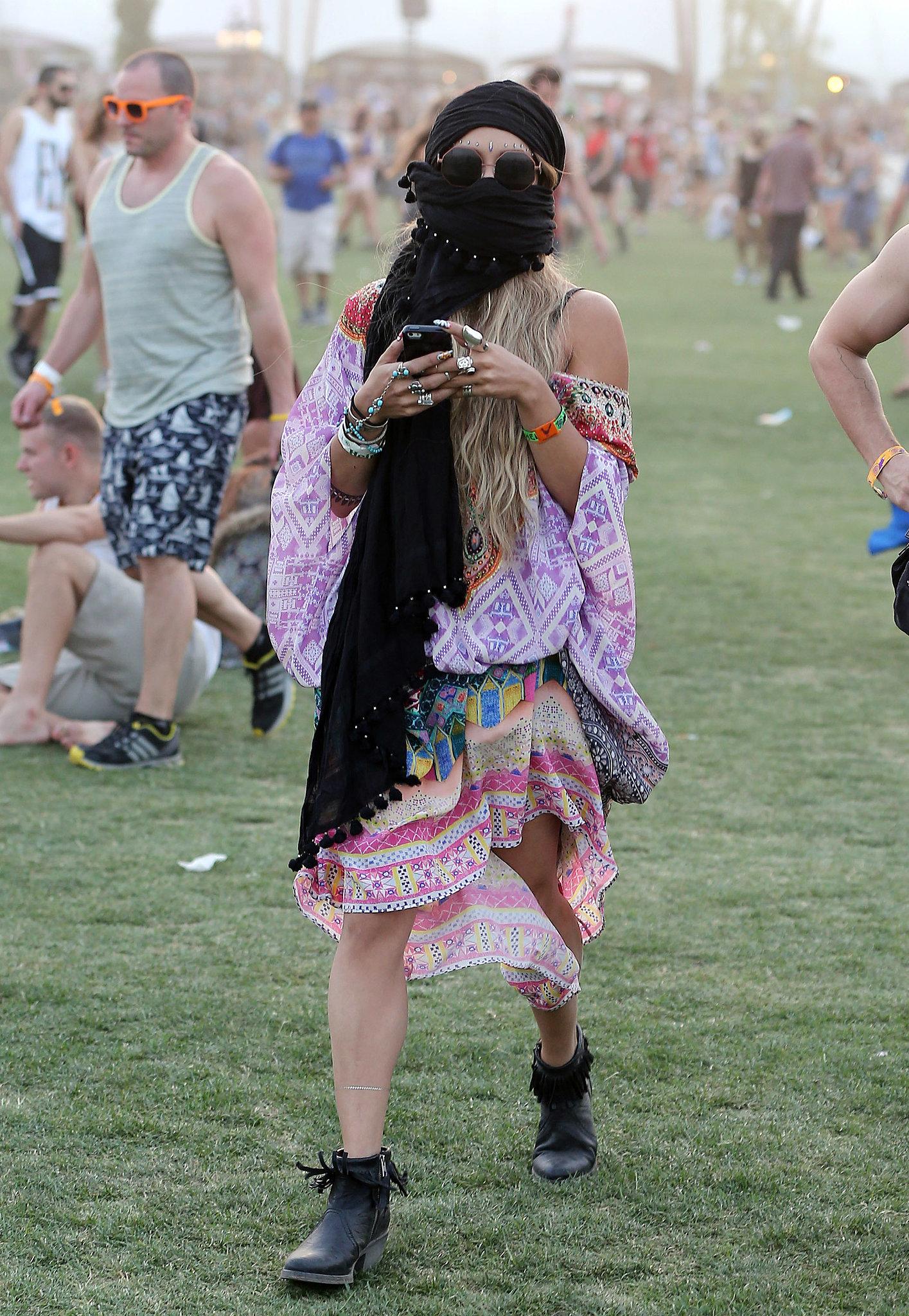 Vanessa Hudgens braved a sandstorm with a black scarf.