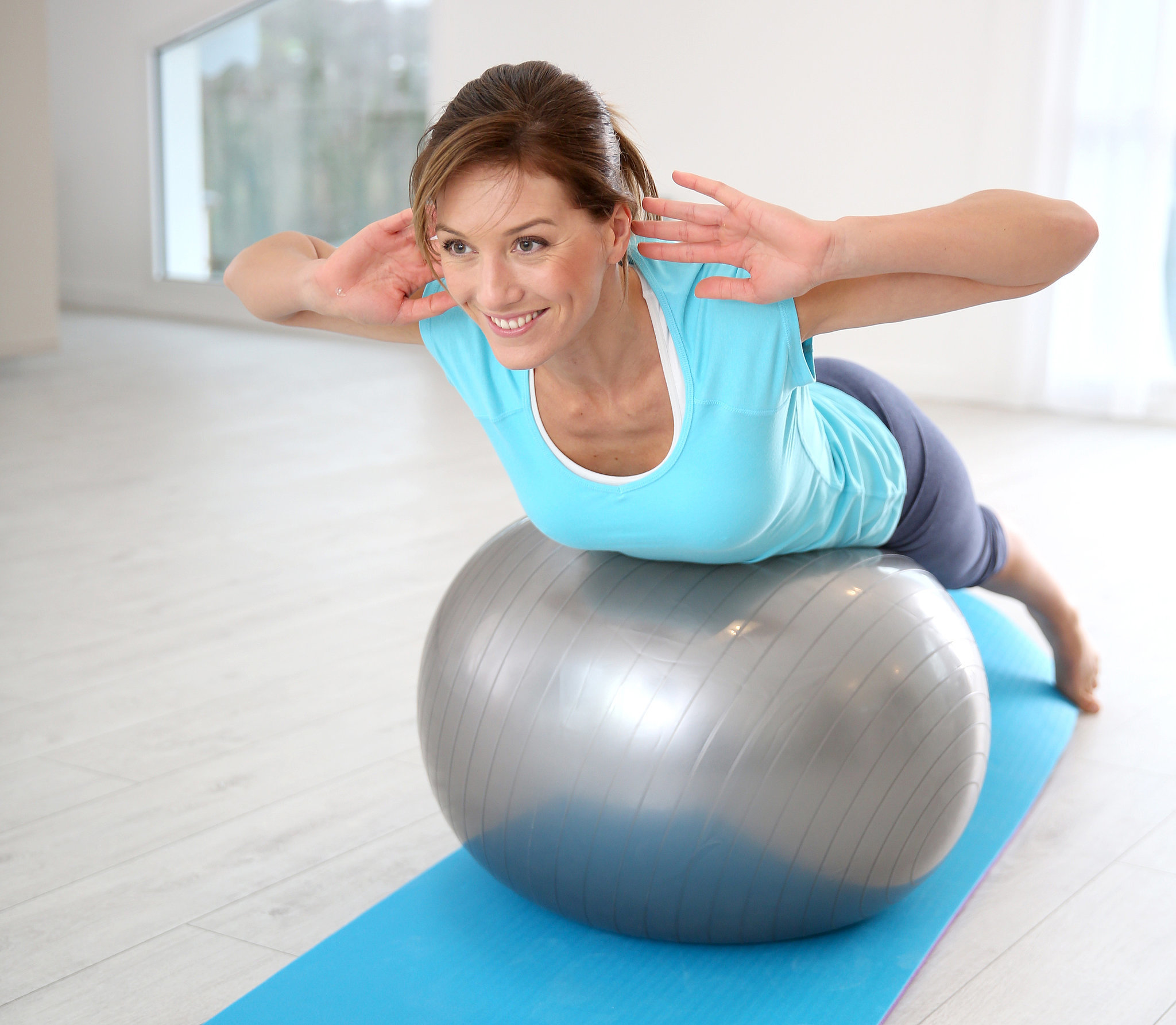 Stability Ball Upper Body Workout: Tame Back Bulge With 4 Exercise-Ball