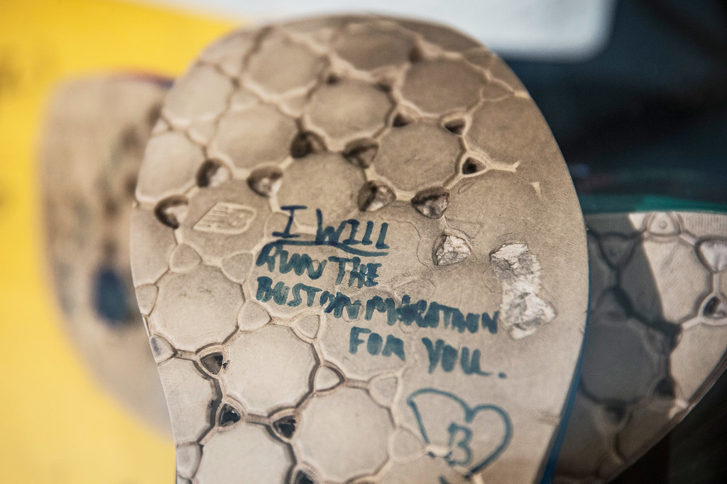 """One of the shoes on display read, """"I will run the Boston Marathon for you."""""""