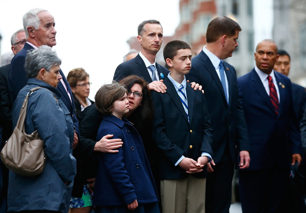 The families and friends of Boston Marathon bombing victims gathered for a wreath-laying ceremony near the finish line.