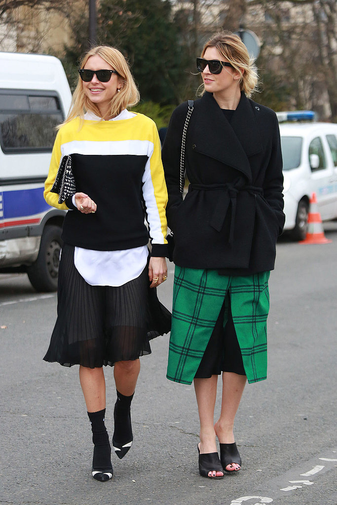 Camille Charrière's (right) slides feel much easier and a lot fresher than a pair of booties would.  Source: Tim Regas