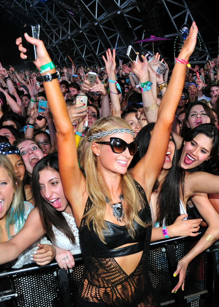 Paris Hilton struck a pose while watching a performance from the very front.