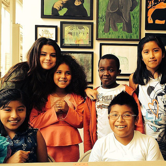 """Selena Gomez took a photo with kids at the Heart of Los Angeles center, which provides the community's youth with programs in academics, arts, and athletics. Selena wrote in the caption, """"You do amazing things for the children of Los Angeles. Thank you for letting me stop by!"""" Source: Instagram user selenagomez"""