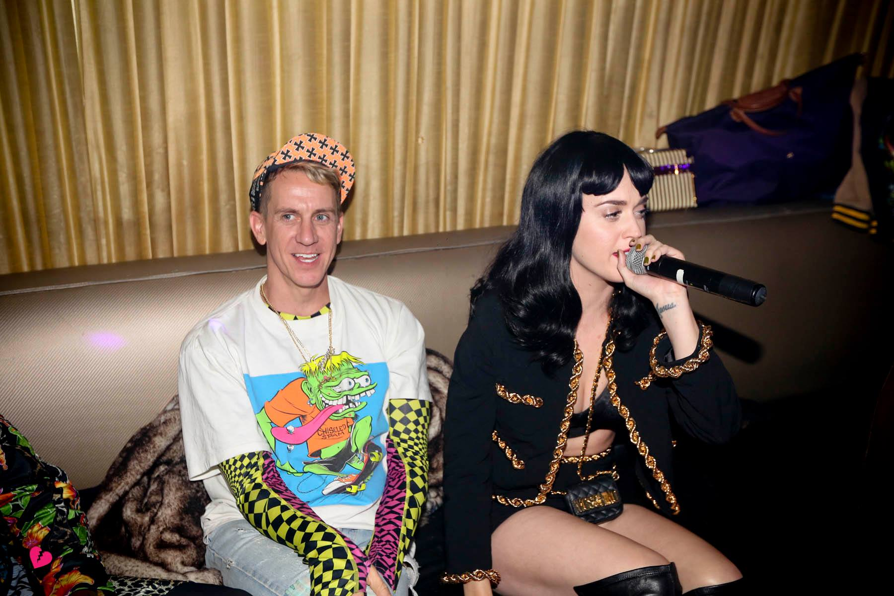 Katy Perry talked into a microphone alongside friend and designer Jeremy Scott. Source: Facebook user 1 Oak NY