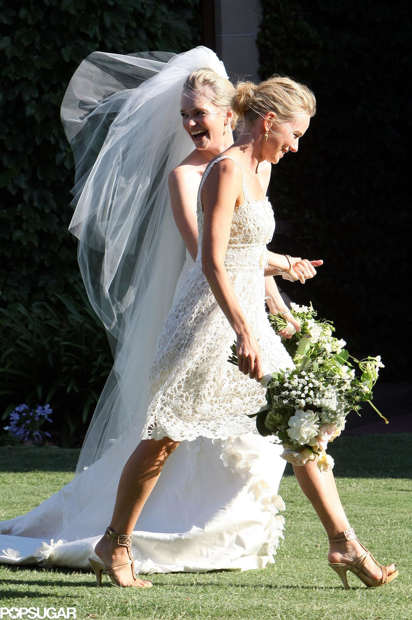 Naomi Watts carried a bouquet alongside the bride, Emma Cooper, at the December 2010 nuptials in Sydney, Australia.