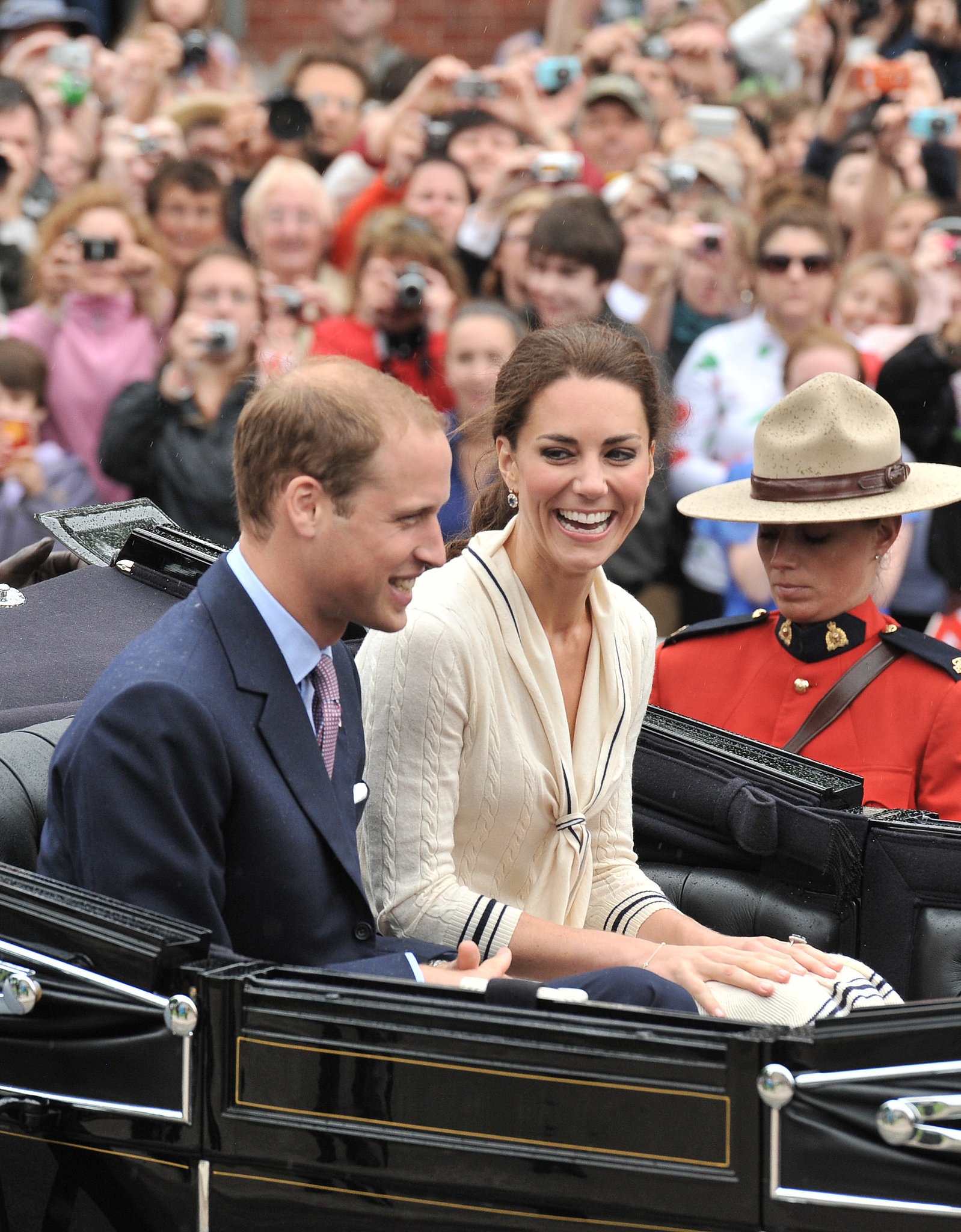 Kate Middleton and Prince William shared a laugh on Prince Edward Island in July 2011.
