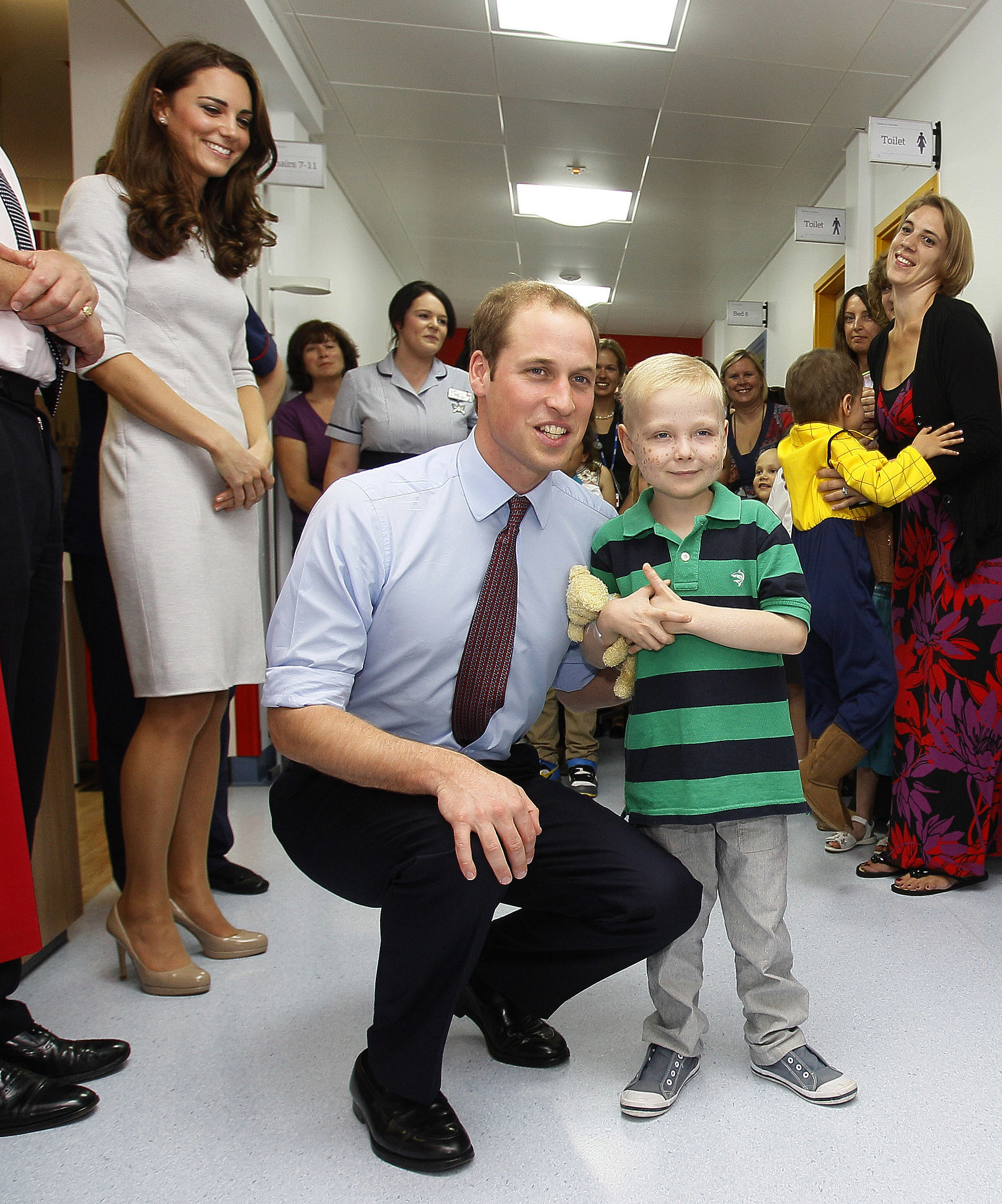 Kate Middleton looked on while Prince William posed with a young boy at London's Royal Marsden Hospital in September 2011.