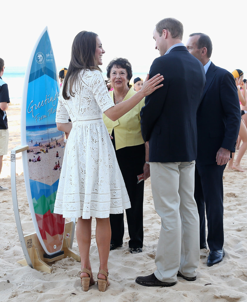 Catherine put her hand on her husband as they were presented with a surfboard on Sydney's Manley Beach during their 2014 tour of the country.