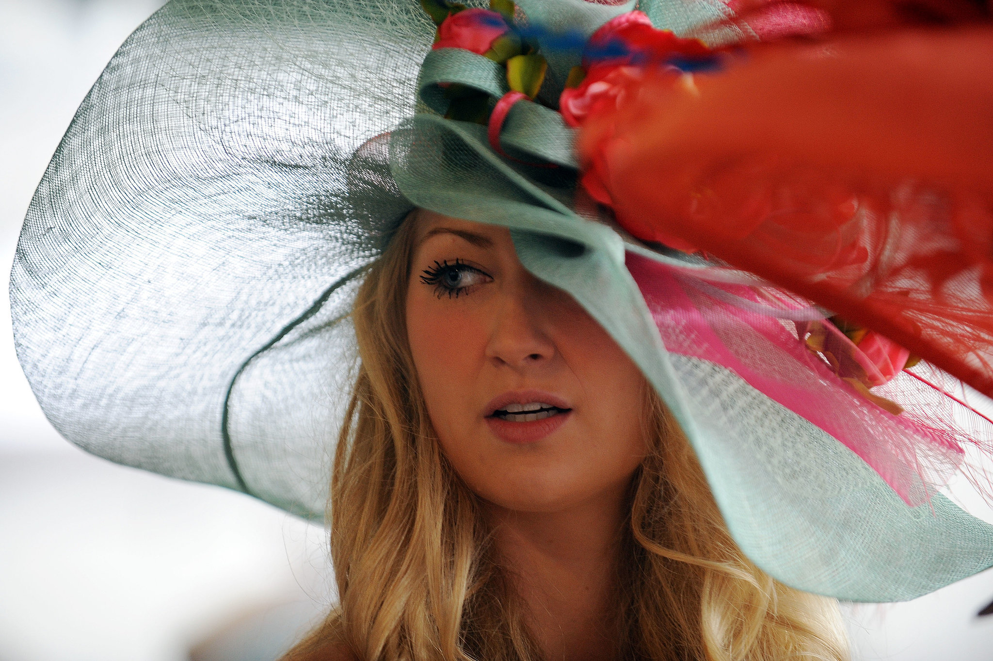 A floppy hat with all the bells and whistles adorned this woman in 2013.