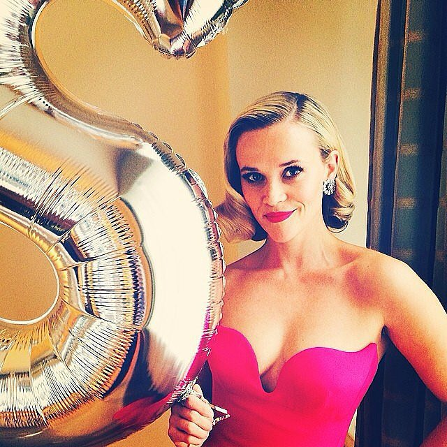 "Reese posed aside Stella's big ""S"" balloon.  Source: Instagram user reesewitherspoon"
