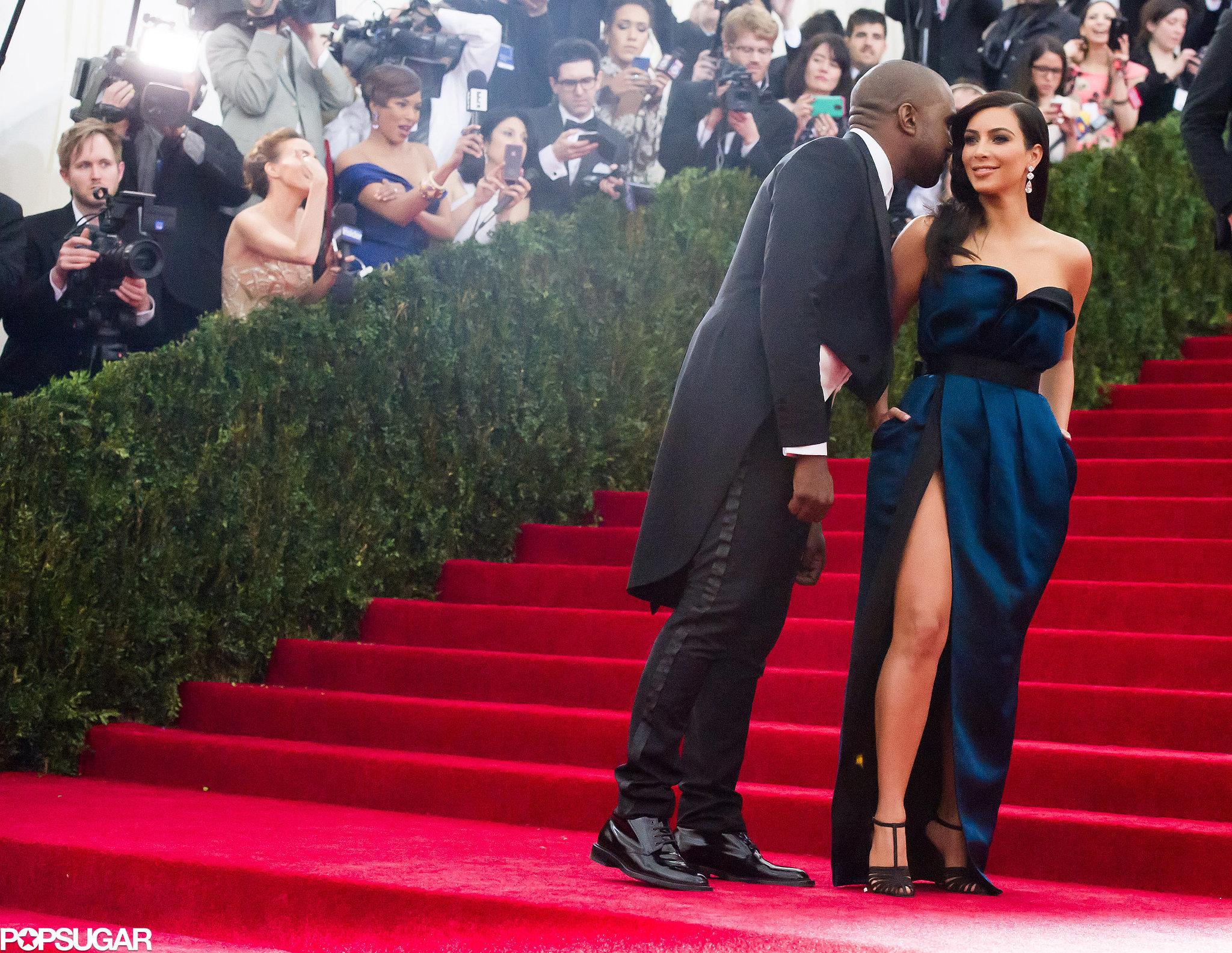 Kanye West whispered in Kim Kardashian's ear during their red carpet run.