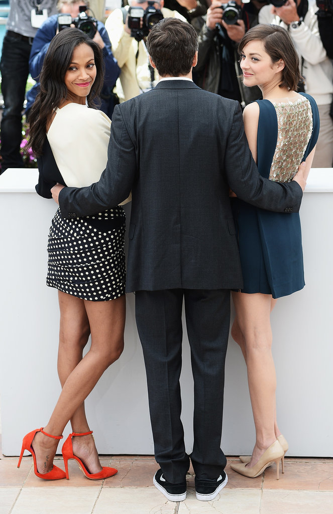 Zoe Saldana and Marion Cotillard posed with Guillame Canet at a photo call for Blood Ties in 2013.
