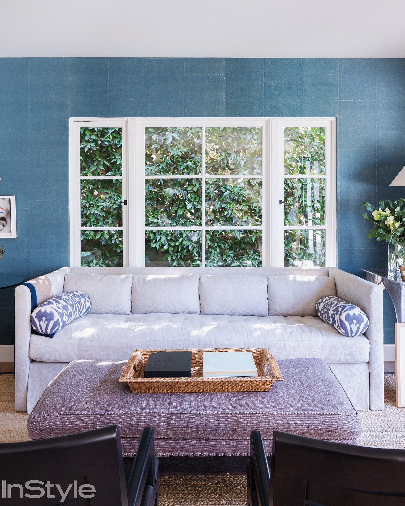 The textural blue wall covering in her living room adds instant serenity. Source: Dean Kaufman for InStyle