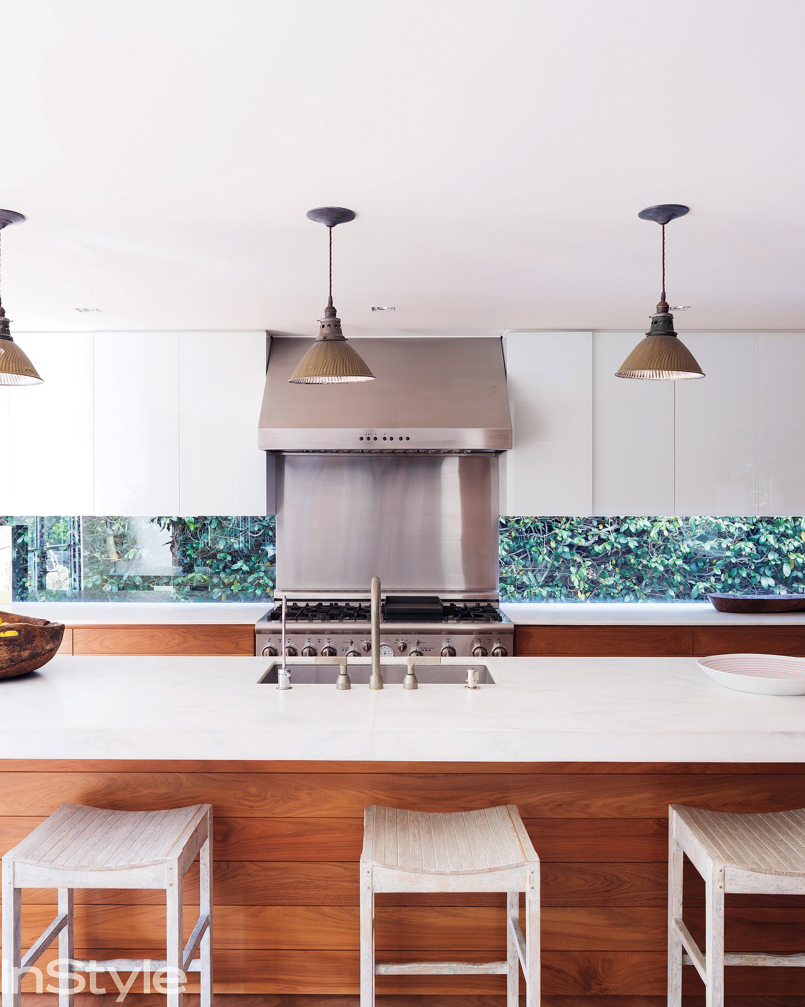 A peekaboo backsplash made from glass brings the outdoors into the kitchen.   Source: Dean Kaufman for InStyle