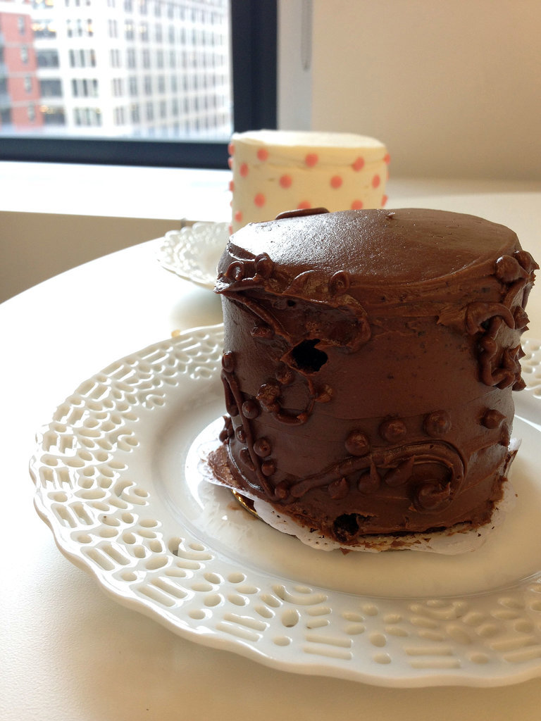 """Devil's Food With Chocolate Buttercream """"This tastes expensive!"""" said one taster of this incredibly rich chocolate cake (pictured foreground), which was a spot-on way to capture the flavor of a classic chocolate cake with slightly bitter dark chocolate undertones. Though it didn't taste too sweet, the cake delivered a sugar high within a few bites, because it was incredibly dense, almost like a flourless chocolate cake.  Classic Vanilla With Vanilla Buttercream Though our tasters preferred the more exotic devil's food and carrot cake flavors, we admitted that this was a classic and delicious vanilla cake (pictured background) with just the right amount of sweetness — and maybe a touch too much frosting. But still, it would be hard to go wrong with this choice. Photo: Nancy Einhart"""