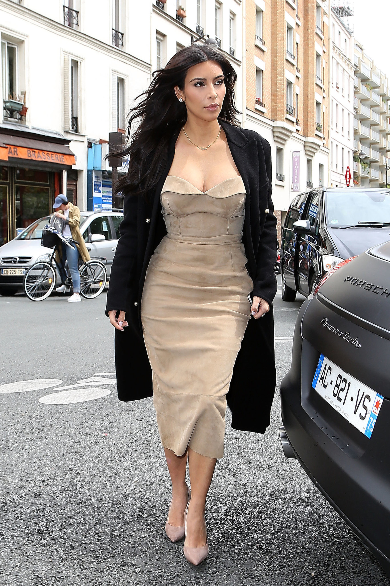 On May 21, Kim topped off a suede strapless dress with an overcoat
