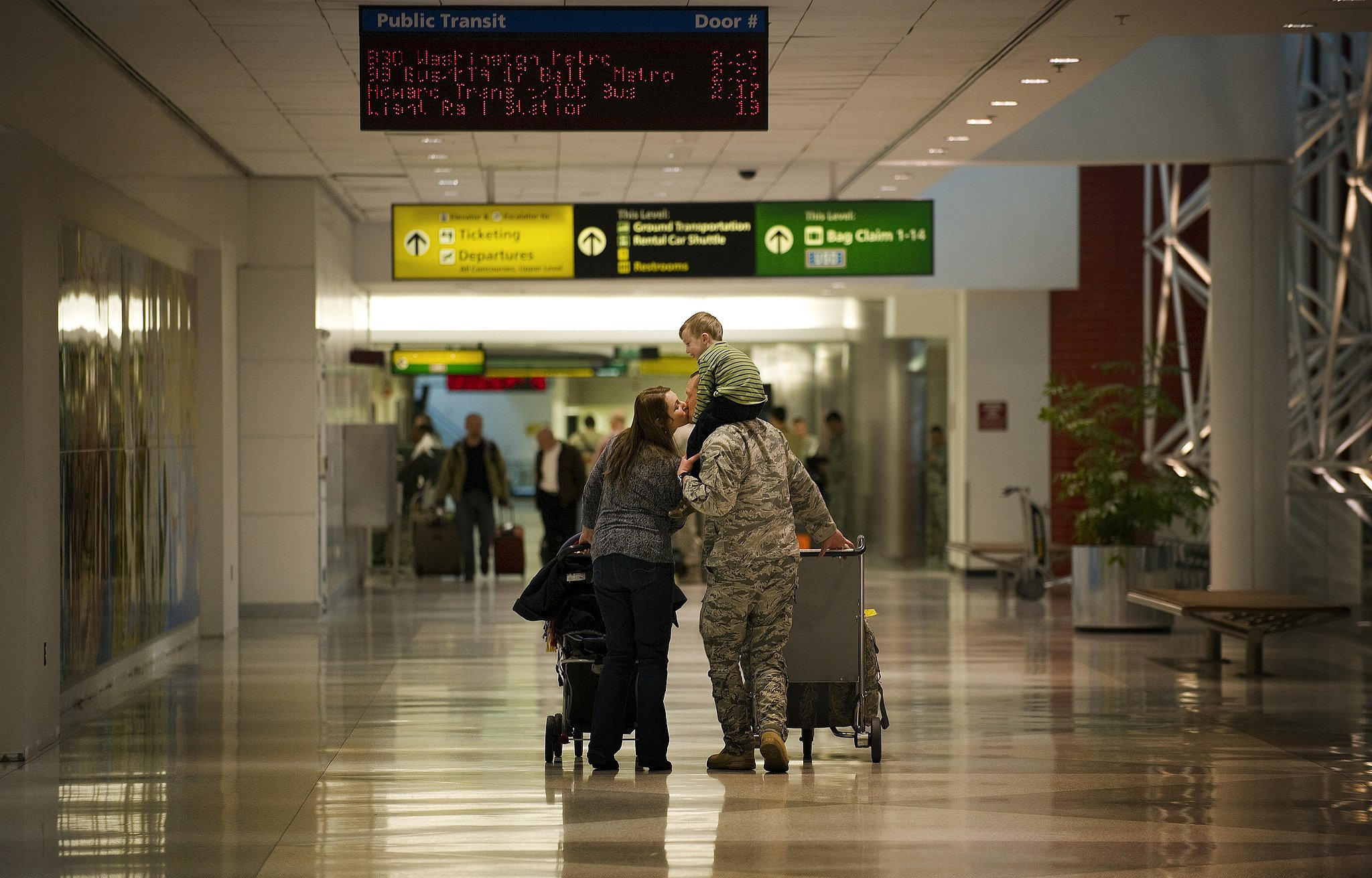 One of the the last Air Force personnel to return from Iraq, Major Steven Vilpors, Commander of the 22nd Expeditionary Weather Squadron, kissed his wife, Joanne, while giving his son Connor a ride on his shoulders at Baltimore Washington International Airport in Baltimore on Dec. 20, 2011.