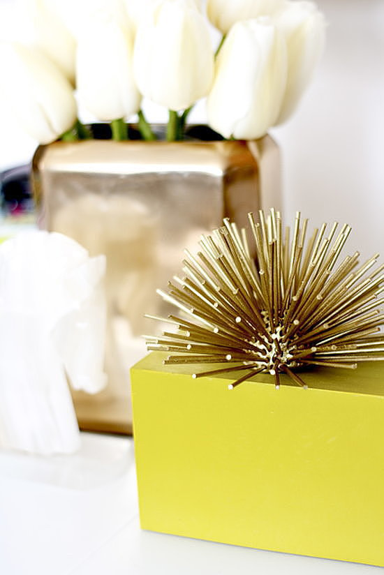 Forget pining for pricier versions, this DIY brass urchin can be whipped up with oven-bake clay, mini wooden dowels, and gold spray paint. Done! Source: Craft and Couture