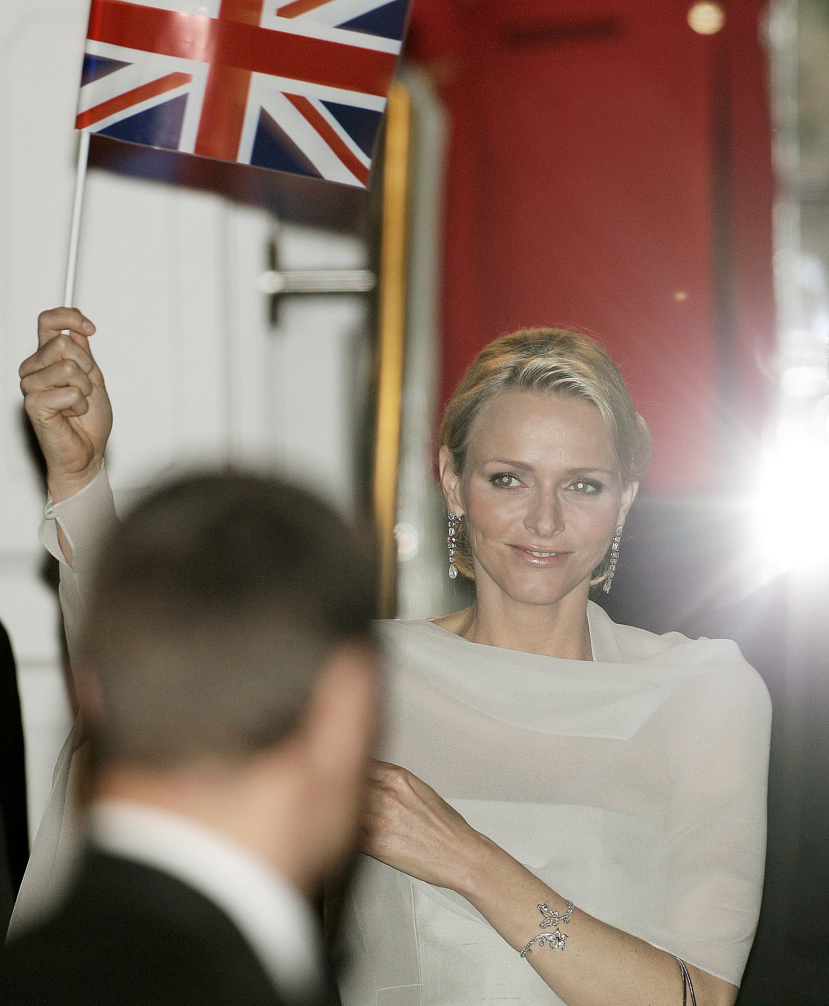 She held up a flag as she left a prewedding gala ahead of Prince William and Kate Middleton's wedding.  Source: Getty / Matthew Lloyd