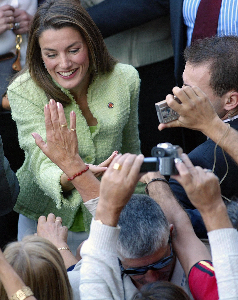She greeted people at the Cathedral of Santiago during a visit with Prince Felipe.