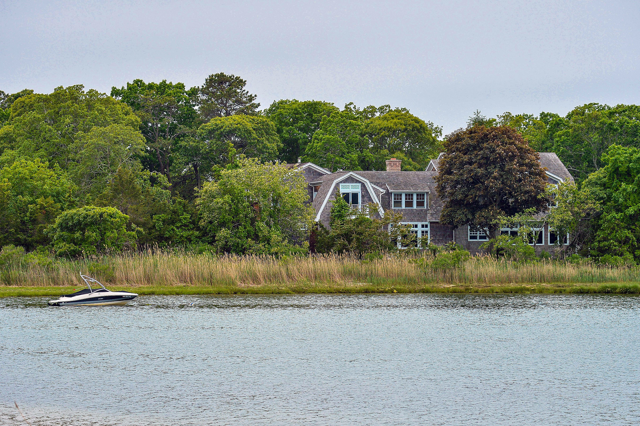 Situated on three acres, the waterfront house comes complete with a private dock and heated pool.