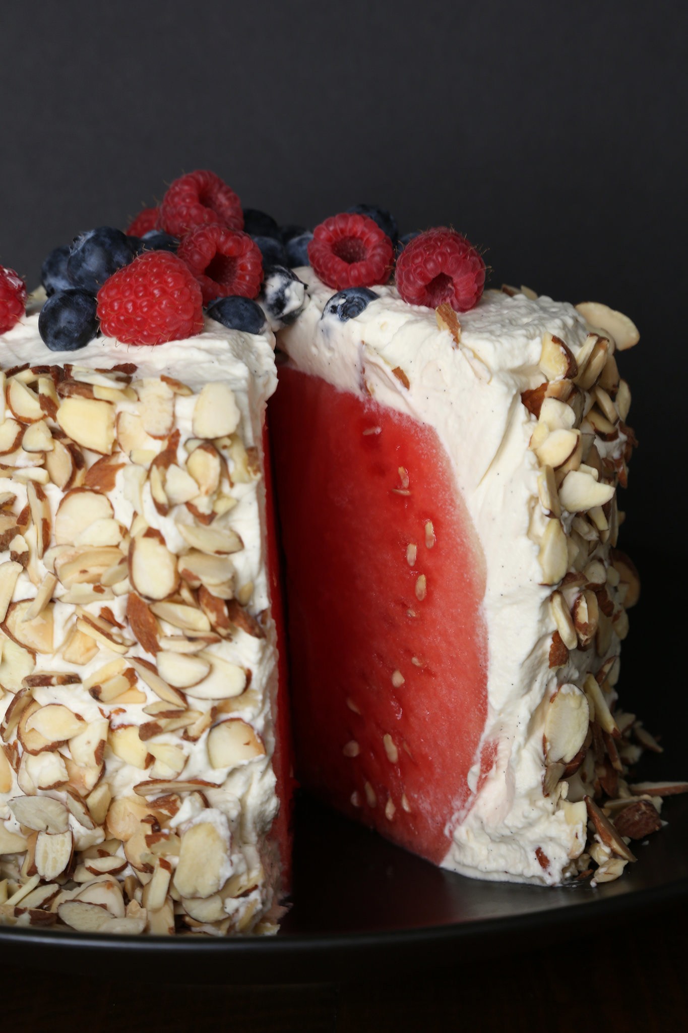 in for the actual cake in this whipped-cream-slathered watermelon cake ...