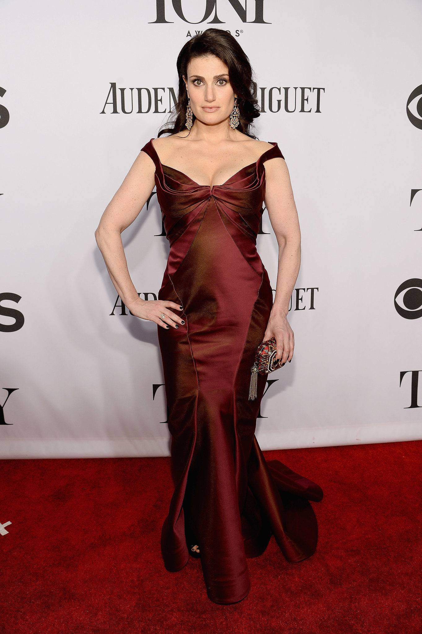 Idina Menzel wore a dark red frock.