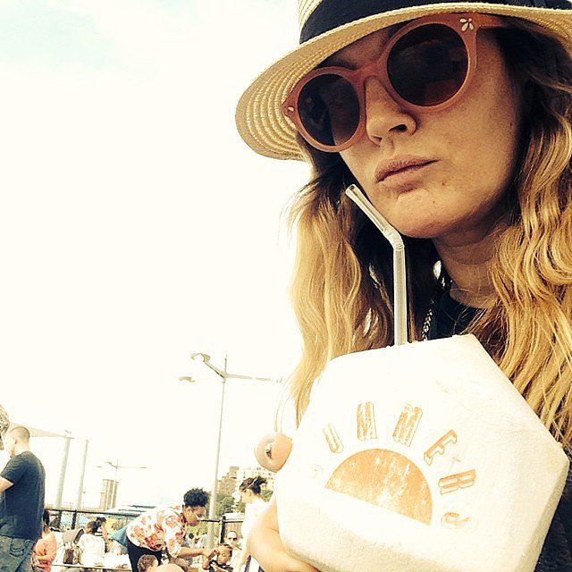 Drew Barrymore sipped straight out of a coconut. Source: Instagram user drewbarrymore