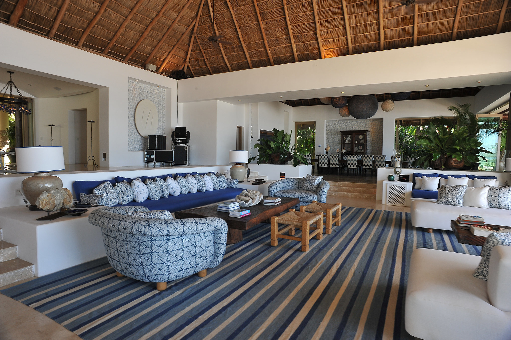 The living room's open layout leads out to the patio and offers plenty of space to relax.