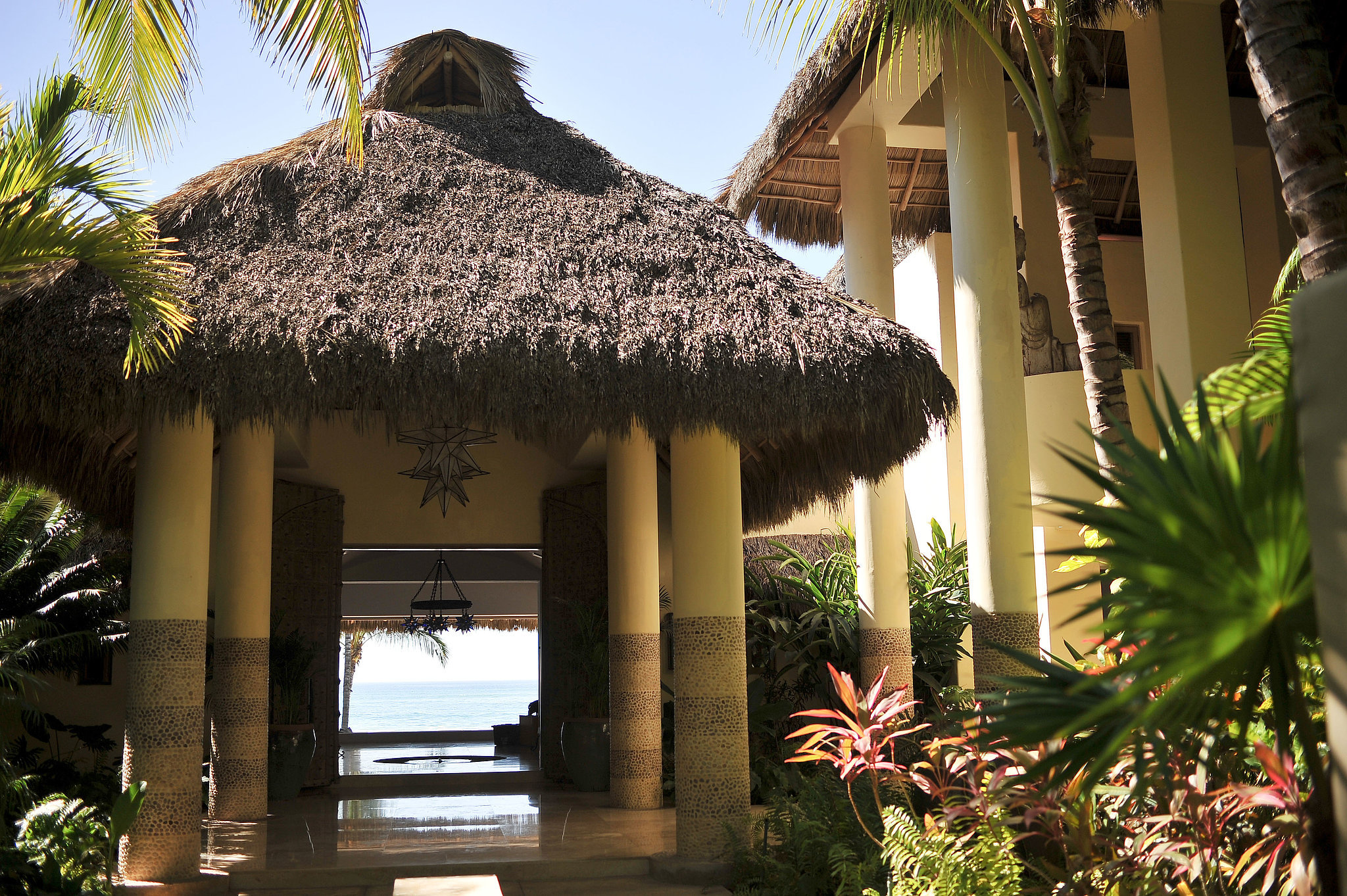 Ocean views and a traditional grass roof make quite the entrance.